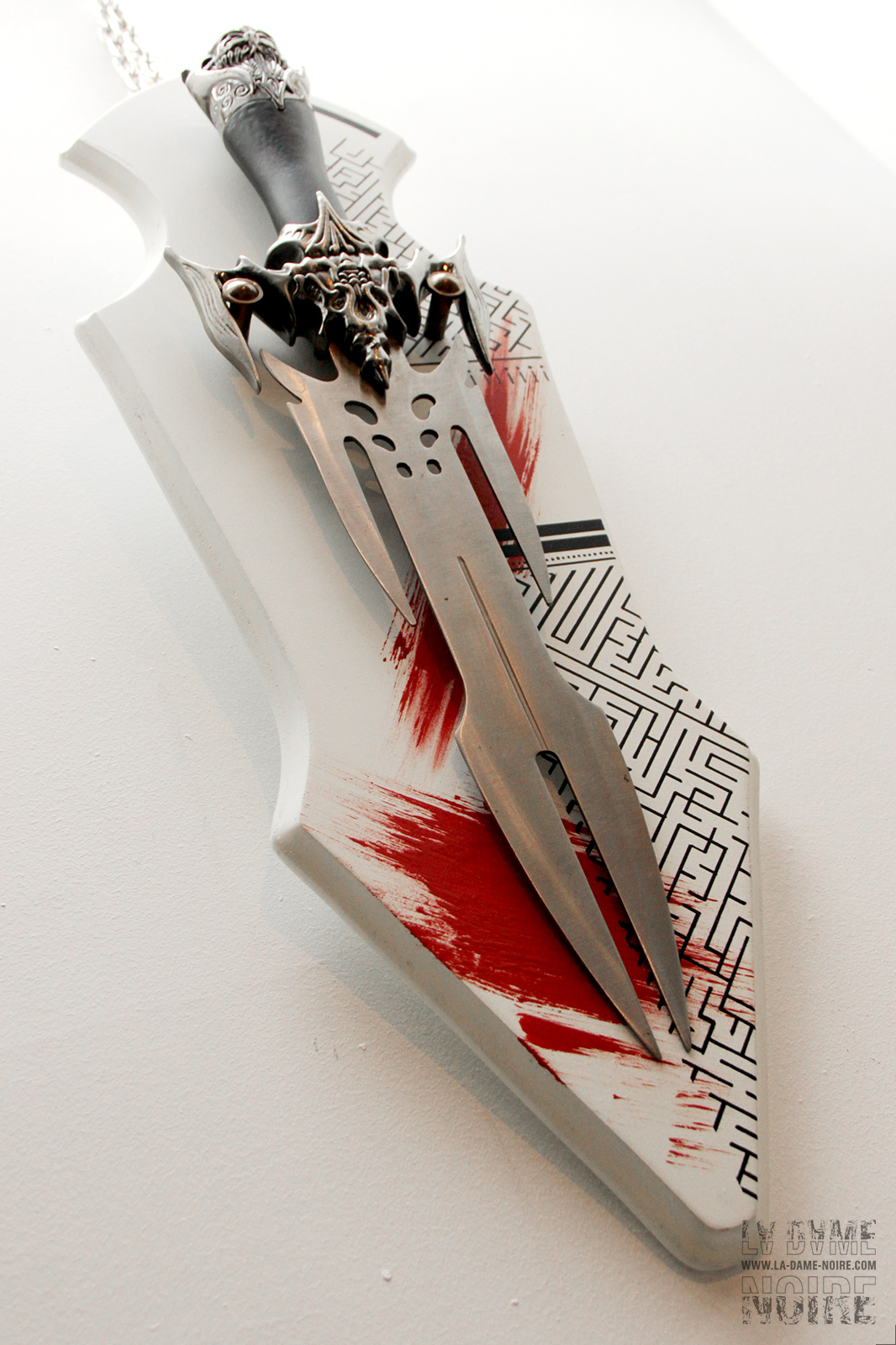 Details of a fantasy viking sword painted in white and red