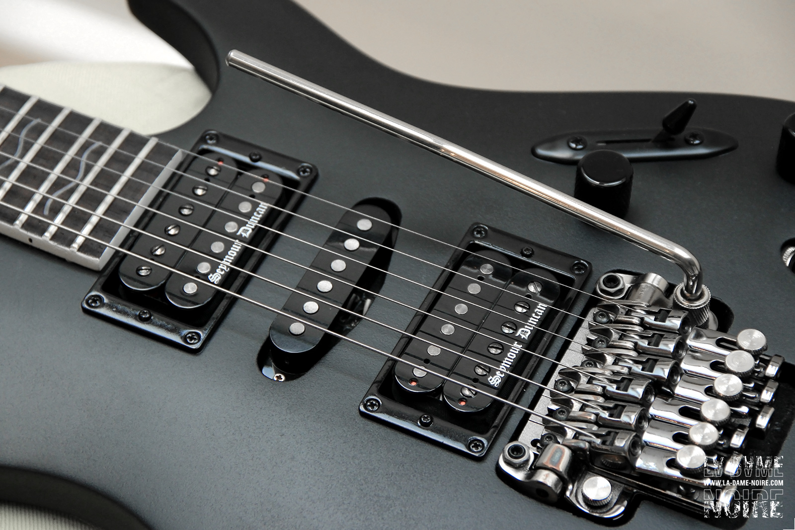 Picture of the guitar body painted in black with new humbuckers Black Winter